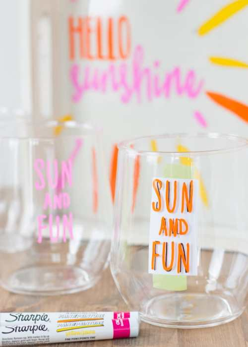 DIY Sharpie Crafts - This custom wine tray with matching glasses requires no artistic ability, stencils, or transfers. If you can trace you can make this craft project! Learn the easy hack for perfect lettering and graphics PLUS get 4 free printable patterns. Oil based Sharpie paint pens make the project mess free. Perfect for a girls' craft weekend, wine club activity, or Pinterest craft party.