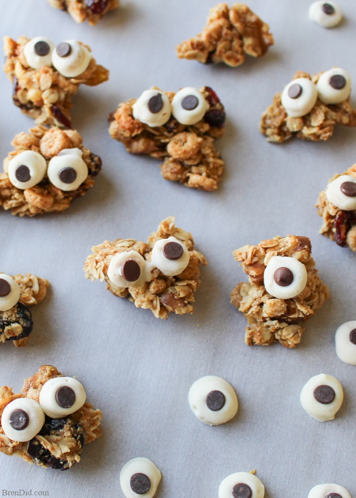 Need a tasty snack kids love? Maple Nut Granola Clusters are a sweet treat made with pure maple syrup. They are a fun alternative to store bought candy and that make healthy Halloween treats. DIY Edible Chocolate Eyeballs & free printable Halloween Goodie Bag Toppers turn them into granola monsters. Perfect Healthy Halloween Treats for Kids.