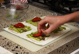 Sit the tomatoes on the asparagus