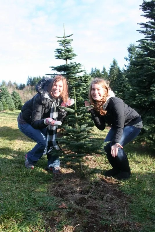 Charlie? - Ashley and Kaylah show some love for Charlie Brown's tree.