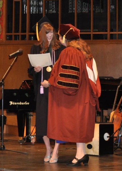 Ashley getting a certificate for clinical excellence from Dean Lucy Krull