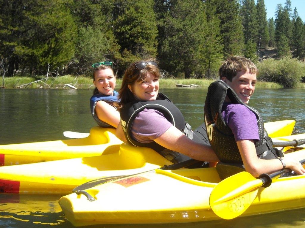 Melissa, Suzi, and Jamison form the yellow kayak team