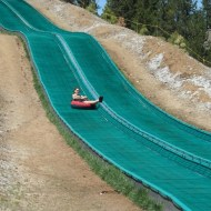 Heather zipping down the tubing hill