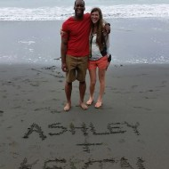 Ashley and Kevin on a *beach* (note the land, water, and sand)