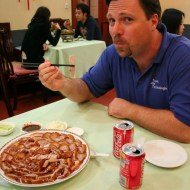 "Kevin enjoying duck in ""Peking"""