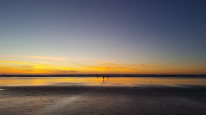 A wide, flat beach after sunset