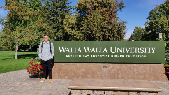 Jamison stands by the WWU sign on his first day of school