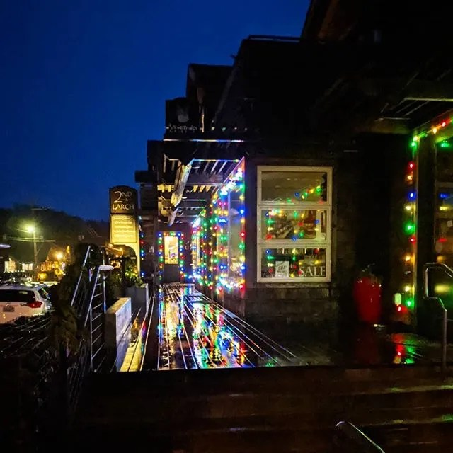 Christmas lights on the walkway by Insomnia at Cannon Beach