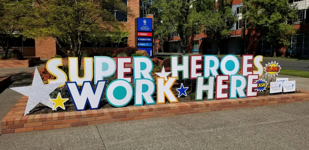 Super heroes work here sign in front of hospital