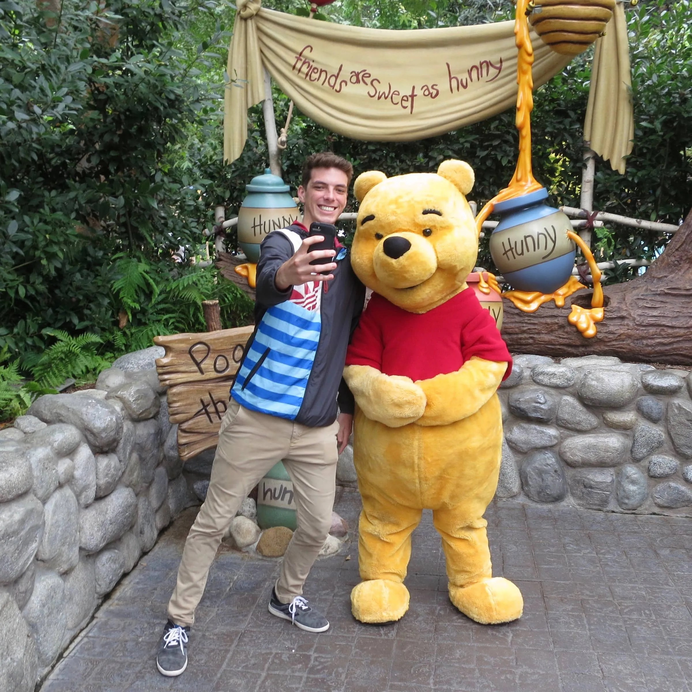 Jamison takes a selfie with Winnie the Pooh
