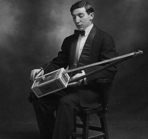 1920s Cigar Box Guitar Player with a 2-String