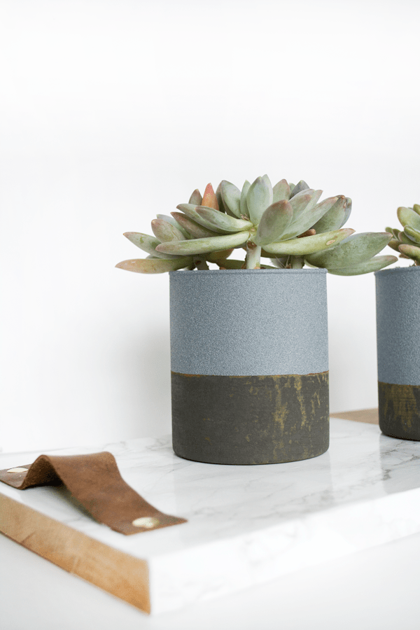 Create a unique rust patina on top of a faux concrete finish on these little planters!