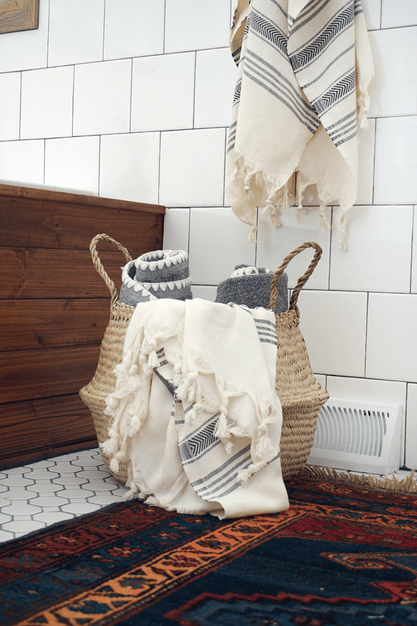 belly basket in the bathroom for towel storage