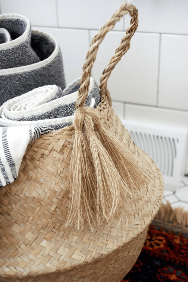A Belly basket with tassels for holding towels