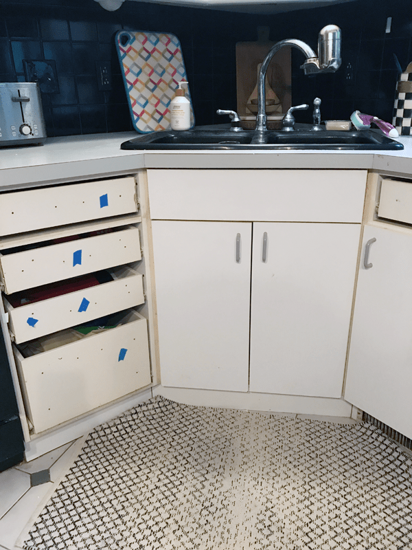 How to Paint and Add Trim to Laminate Cabinets