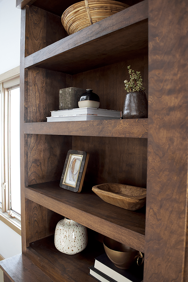 Books and vases used in open shelving