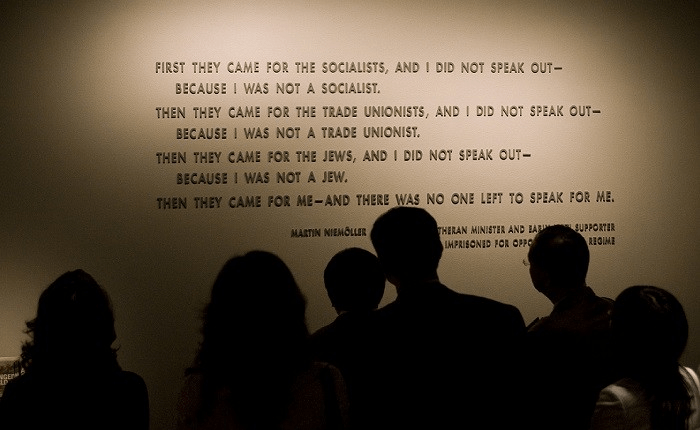 Museum visitors in front of the Martin Niemöller quotation at the United States Holocaust Memorial Museum. (n.d.).
