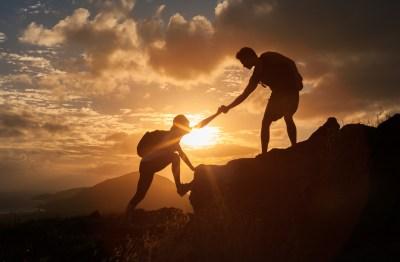 hand up, help climbing mountain