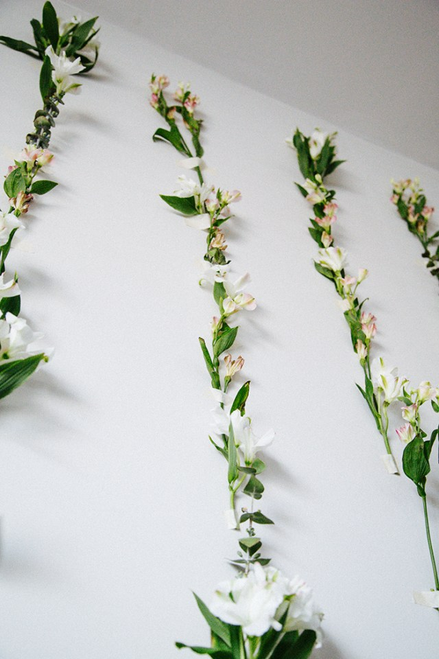 Create an easy and beautiful backdrop for any party, event or photoshoot in minutes with this DIY Tape Fresh Flower Wall. | brewedtogether.com