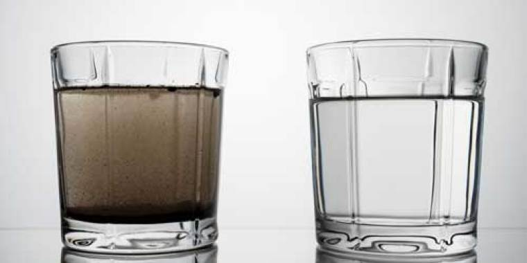 Two glasses of cloudy and clean water