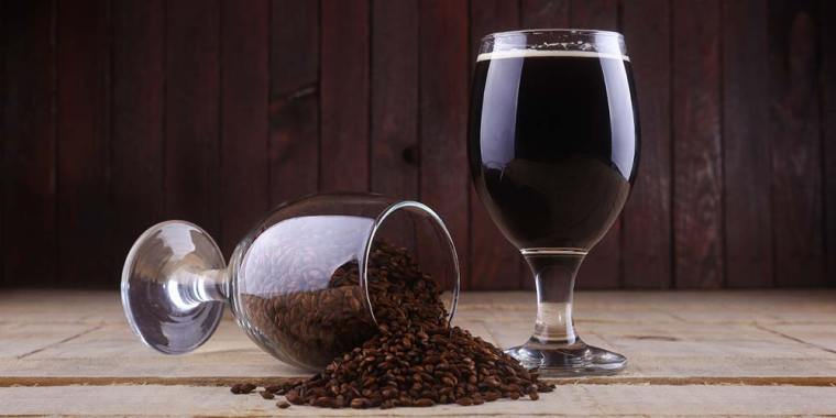 Glass of dark beer and a glass of smoked grains