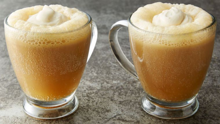 Two mugs of butterbeer.