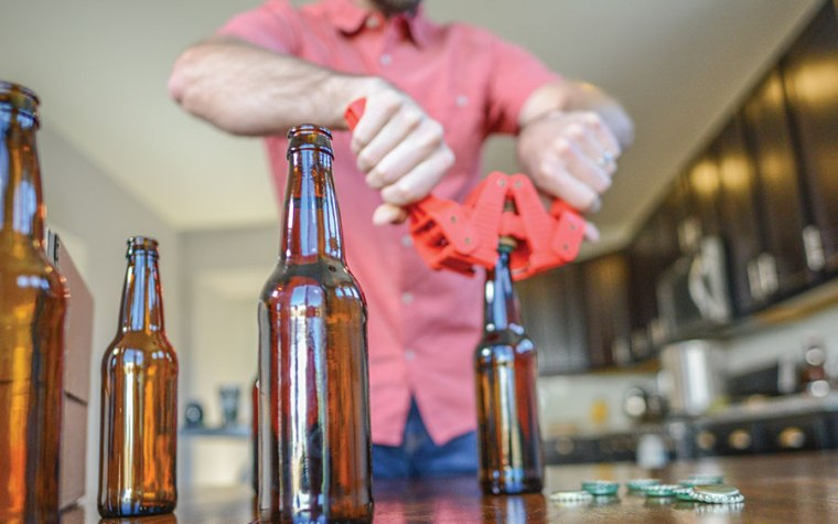 Capping a beer bottle