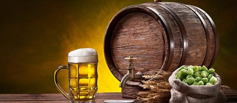 A beer barrel, mug of beer, sack of hops and some wheat.