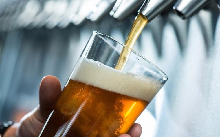 Pouring a glass of beer from a tap