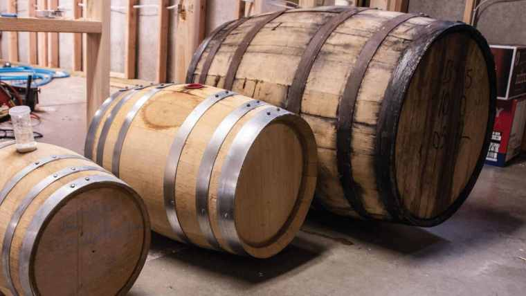 Three wooden barrels for beer ageing with different sizes.