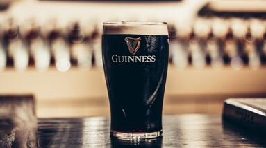 A glass of Guinness beer on a table