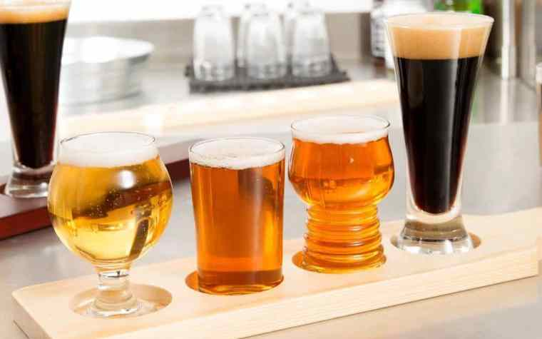 Different types of beer in different types of glasses.