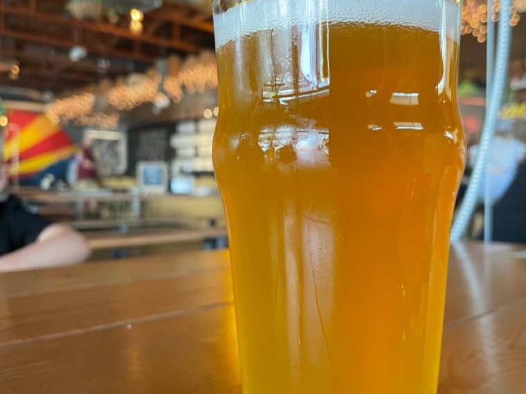 A glass of Sonora White beer from Arizona brewery.