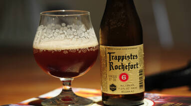 A glass and a bottle of Trappist Monk beer