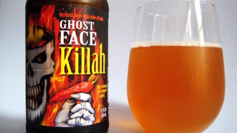 A bottle and a glass of Ghost Face Killah beer with ghost peppers.