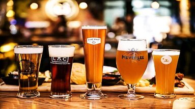 Various craft beer in different glasses on a table.