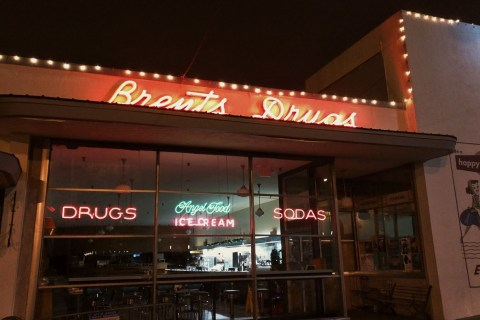Brent's Drugs store front at night.