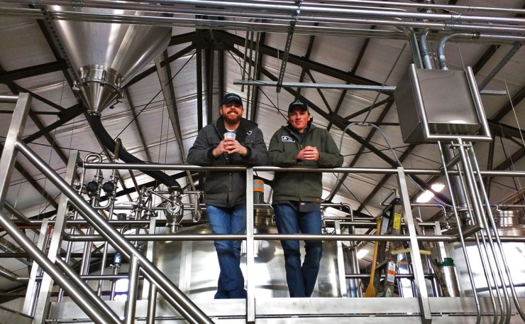 Brews atop the brewing equipment at Lucky Town Brewing
