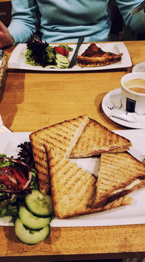 A shot of a quiche and panini with salad at a Brussels cafe.