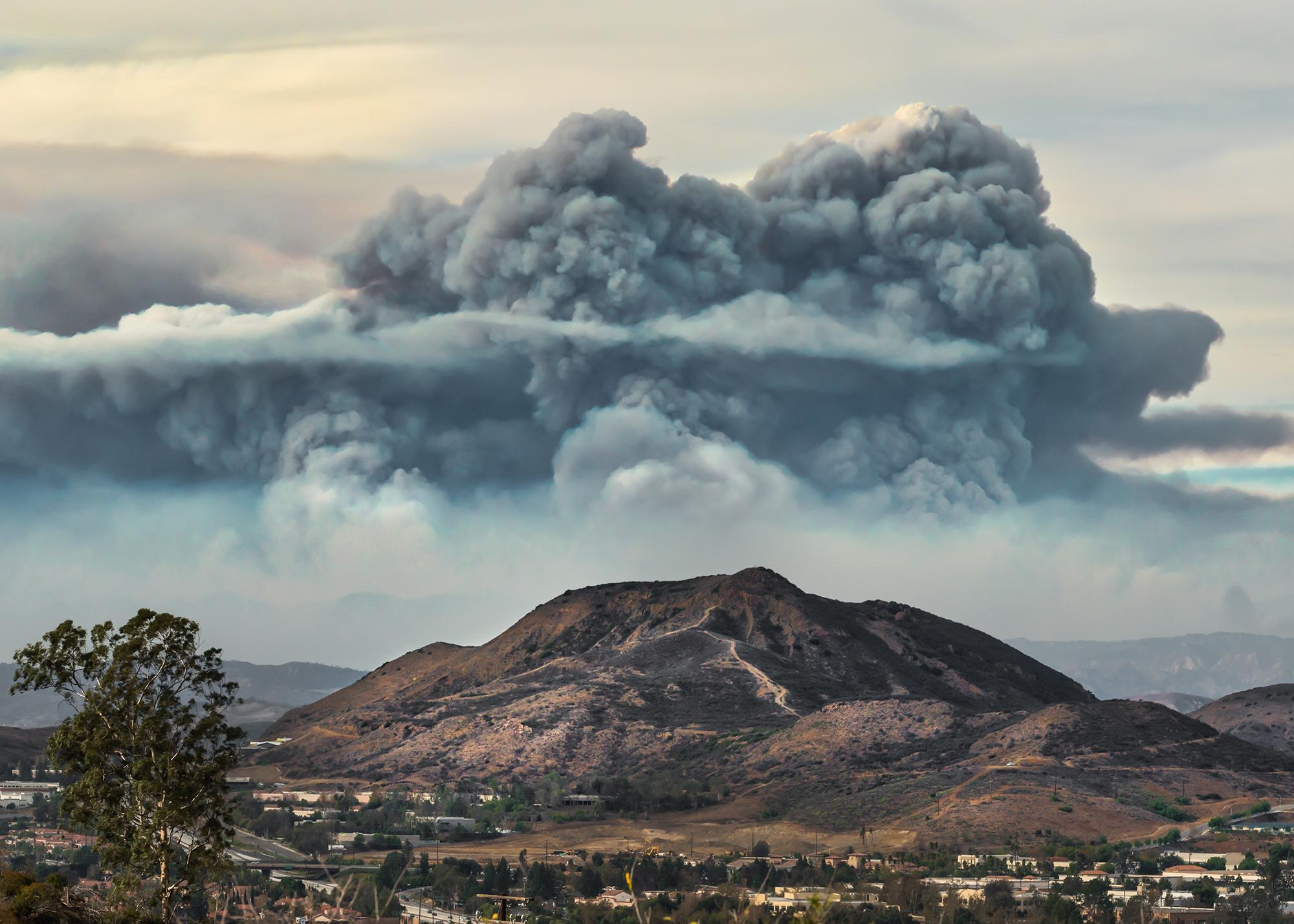 The thomas fire raises above southern california mountains.