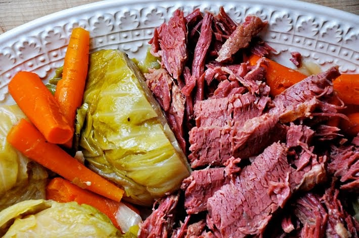 A plate of Irish corned beef and cabbage with carrots.