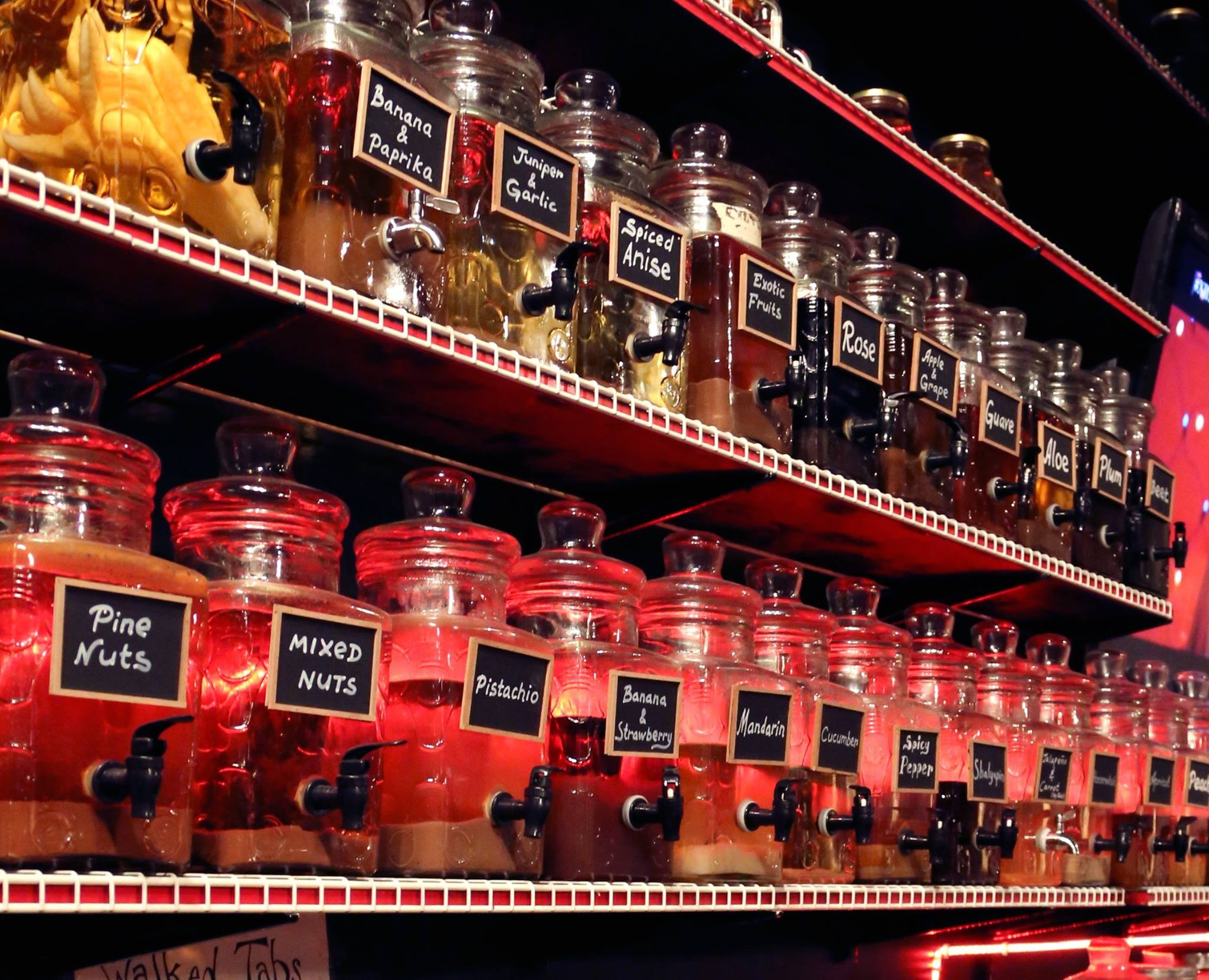 The wall of infused vodkas in jars at The Russian House in Austin