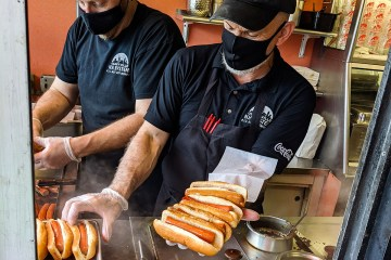 Prepping an armful of hot weiners at Olneyville New York System