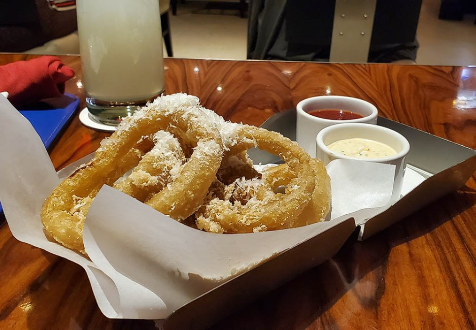 Side of parmesan dusted onion rings.