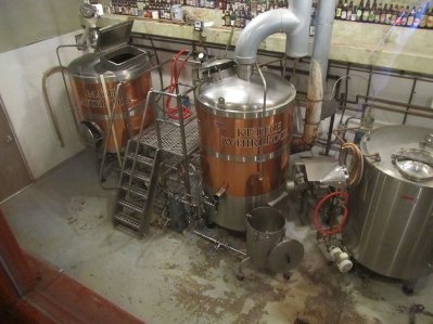 From the dinning room you look down on to the brewery in the basement. Here you see the Mashtun and kettle.