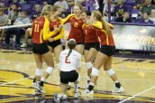 The Cyclone Volleyball team celebrates the win of their first set against UNI on Sept. 4, in Cedar Falls.