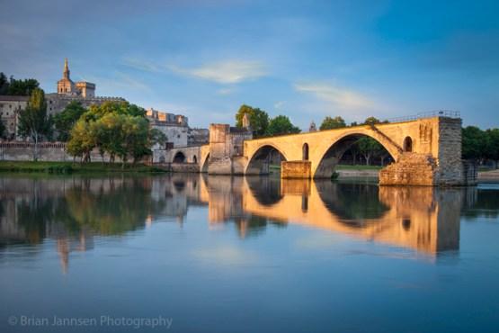 Sunrise over Pont Saint Benezet, Palais des Papes, and the medieval town of Avignon, Provence France