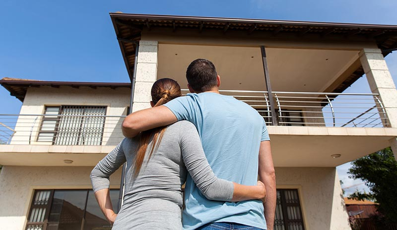 couple admiring their new home mortgage after bankruptcy
