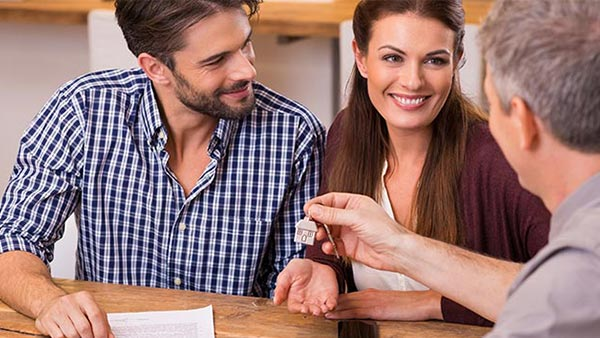 Young couple closing on a home mortgage using Nationwide High Balance Loans.