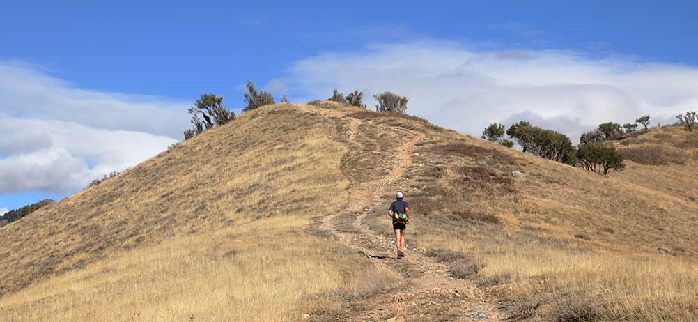 trail runner on a hiking trail in the foothills near Golden, Colorado